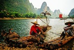Li River cormorant fishermen relaxing on their bamboo rafts near Yangshuo (Guilin area)