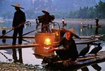 Li River cormorant fishermen light lanterns for night fishing near Yangshuo (Guilin area)