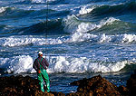Indian Ocean sport fisherman with heavy surf at George