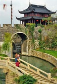 Suzhou's Pan Men water gate from Grand Canal through old city wall into city