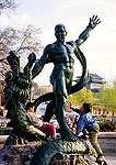 Harbin statue of man and dragon with children playing on it