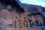 Longmen Buddhist Grottoes with Buddha and guardians in Fengxian temple.