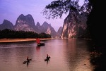 Li River near Yangshuo (Guilin area) with fishermen on bamboo rafts and sail boat