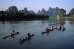 Li River cormorant fishermen on their bamboo rafts in morning at Yangshuo (Guilin area)