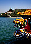 Beijing's Summer Palace dragon cruise boat for tourists on Kunming Lake with Longevity Hill in background