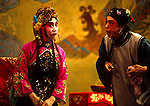 Beijing Opera's Sunyujiang and the Matchmaker in performance of The Jade Bracelet at the Liyuan Theater at the Qianmen Hotel