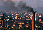 Pollution from smoke stack in city