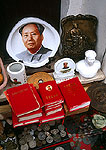 Mao memorabilia for sale at kiosk on restored Song dynasty street  in Tunxi (Huangshan City) includes Mao buttons and Little Red books