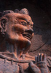 Longmen Buddhist Grottoes, warrior in Fengxian temple