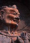 Longmen Buddhist Grottoes, warrior in Fengxian temple