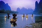 Li River cormorant fishermen at night with lanterns on their bamboo rafts near Xingping (Guilin area)