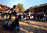 Naxi nationality women in Lijiang Old Town dancing at annual San Duo festival