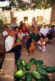 Xinjiang Uygur villagers with watermelons in Shan Shan county near Turpan along ancient Silk Road