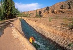 Xinjiang irrigation canal through desert oasis