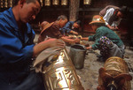 Jokhang Temple prayer wheels being cleaned
