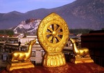 Jokhang Temple roof sculpture with Potala Palace in Background