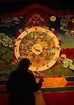 Lhasa's Drepung Monastery wall mural with woman Tibetan pilgrim