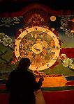 Lhasa's Drepung Monastery wall mural with woman Tibetan pilgrim