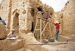 Xinjiang's Jiaohe Ruins restoration by archeaologists on site