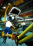 Shanghai GM factory production line with workers assembling Buick