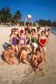 Hainan Island young Chinese vacationers on South China Sea beach at Sanya resort