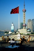 Shanghai's Pudong skyline with Oriental Pearl TV Tower, view from rooftop terrace Bar Rouge of Building 18 on The Bund