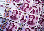 Chinese yuan notes in largest denomination, 100's, of Renminbi (RMB), the
