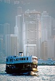 Hong Kong harbor with Star Ferry to Kowloon and Hong Kong Central skyline in background