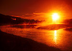 Firehole River at sunrise with steam on autumn morning