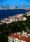 Fisher Island condos with skyline of downtown Miami in distance
