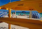 Miami Beach sunbathers, kayaks, and cabanas