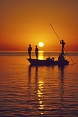Florida Keys fly fishing from a flats boat at sunset near Islamorada.
