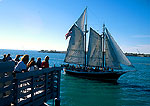 Key West Sunset Pier with tourist schooner on sunset sail