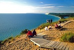 Sleeping Bear Dunes National Lakeshore with visitors at Empire Bluff overlooking Lake Michigan