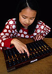 Chinese girl using abacus