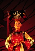 Shanghai Acrobats performance, woman on stage in imperial costume