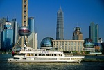 Shanghai's Pudong skyline across the Huangpu River from The Bund,  tourist boat on river