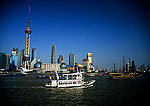 Shanghai's Pudong skyline across the Huangpu River from The Bund,  tourist boats on river