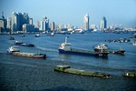 Shanghai's Huangpu River filled with shipping barges and freighters