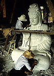 Putuo Shan workers carving Goddess of Mercy (Guanyin) statue on this island for Buddhist pilgrimages