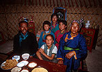 Mongolian family in their yurt on the grasslands near Hohhot