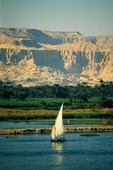 Felucca on the Nile with Valley of the Kings Hatshepsut's Temple in the distance