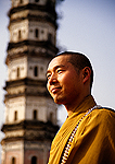 Buddhist monk at Wen Feng (Paint Brush) Pagoda in Huangshan City near south gate to Huangshan (Yellow Mountain)