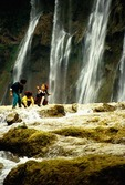 Huangguoshu Falls, largest in China, with children playing in water