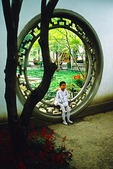 Hangzhou garden moon gate with small child