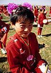 Inner Mongolian drummer girl at annual Naadam Festival on the grasslands