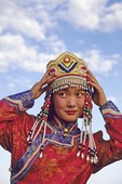 Young Mongolian woman in traditional dress at annual Nadam Festival on the grasslands near Hohhot