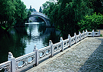 Yangzhou's Slender West Lake with arched stone bridge and marble balustraded porch