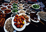 Sichuan style dishes of prepared food at street restaurant in town of Fengdu in the Three Gorges Scenic Area