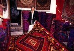 Uighur rug merchant in Kashgar shop